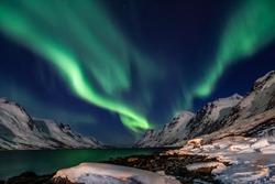 Amazing Aurora Borealis in North Norway (Kvaloya), mountains in the background