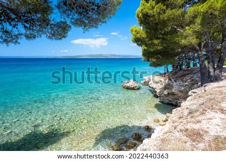 amazing azure adriatic sea in Baska Voda on Makarska riviera in Dalmatia, Croatia Stock fotó ©