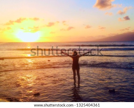 Amazing background care free happy girl on sunset beach #1325404361