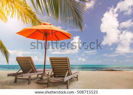 Amazing beach in Maldives. Relaxing blue sky and white sand. Wooden sun beds with sun umbrella. Inspirational luxury travel holiday background concept. #508715521