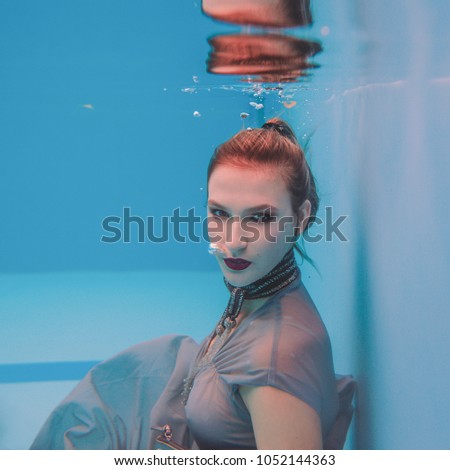 5c27d28326 Amazing beautiful art surreal portrait of young woman in grey dress and  beaded scarf underwater in