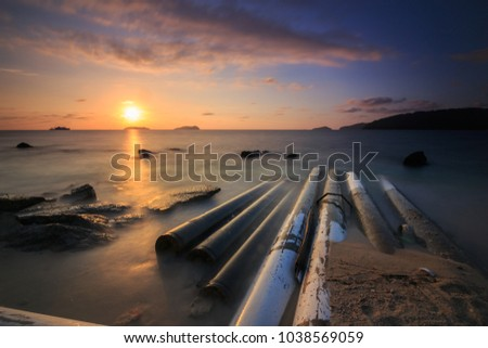 Amazing beautiful Nature of long exposure Sunset Over the Sea with Twilight Sky at Sabah Borneo #1038569059