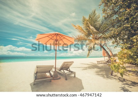 Amazing blue and turquoise sea, deckchairs, white sand and palm trees, sunshine, very beautiful nature background. Luxury summer travel vacation holiday background concept. #467947142