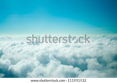 Amazing blue cloudy sky view photographed from the airplane