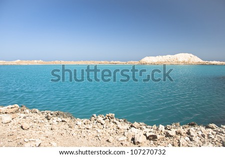 Amazing Blue lake among the sand and rocks