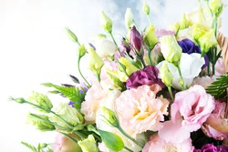Amazing bouquet of colored roses close up. Fresh roses with water drops on the petals and unblown yellow rosebuds in a bouquet. Wedding and Valentine's Day concept