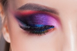 Amazing Bright eye makeup in luxurious blue shades. Pink and blue color, colored eyeshadow. Close up