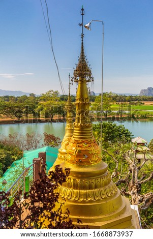 Amazing Buddhist Kyauk Kalap Pagoda under blue sky, Hpa-An Stock fotó ©