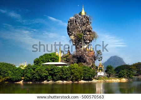 Amazing Buddhist Kyauk Kalap Pagoda under blue sky. Hpa-An, Myanmar (Burma) travel landscapes and destinations Stock fotó ©