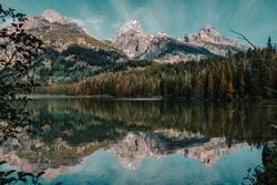 Amazing calm water reflections on Taggart Lake in Grand Teton National Park, Wyoming, USA in the summer.