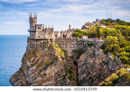 Amazing castle Swallow's Nest on a rock at Black Sea, Crimea, Russia. It is a symbol and landmark of Crimea. Scenic panoramic view of Crimea southern coast. Architecture and nature of Crimea. #1032815599