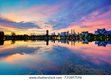 Amazing cityscape Kuala Lumpur at sunrise and blue hour from Titiwangsa Lake. . Image has blurry or soft focus when view at full resolution (Shallow DOF, slightly motion blur). #731897596