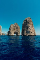 Amazing clear and lightblue sea and sky around the faraglioni of Capri.