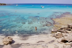 Amazing clear and turquoise water in the blue lagoon bay in the Akamas National Park, Cyprus