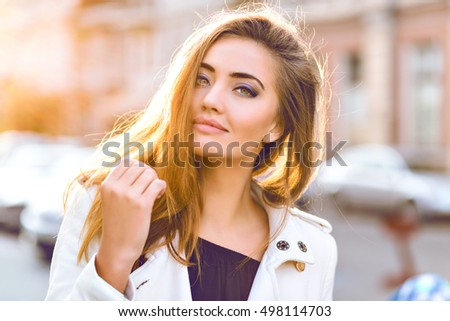 Amazing close up sunny sensual portrait of stunning elegant glamour sexy woman, posing at Europe street, sunny evening colors, perfect skin hairs and make up.