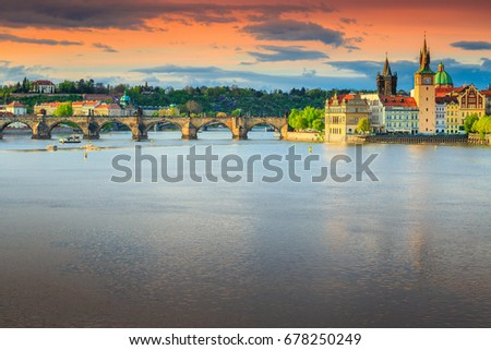 Amazing colorful sunset and spectacular cityscape with old stone Charles bridge in Prague, Czech Republic, Europe #678250249