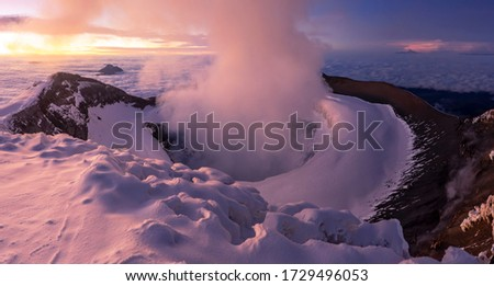 Amazing crater of the volcano Cotopaxi. The top of the volcano Cotopaxi. Sunrise on the volcano. Cotopaxi National Park
