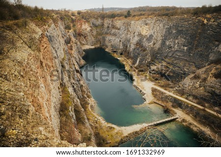 Amazing czech grand canyon (Velka Amerika) Big America in Central Bohemia, Czech Republic (also nicknamed Czech Grand Canyon). Wild nature in a stone canyon background with azure water. Stok fotoğraf ©