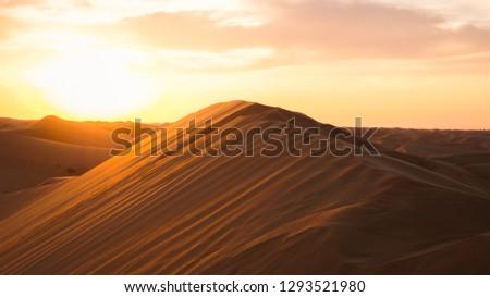 Amazing desert sunset. Beautiful arabian desert with warm colors. Colorful contours of sand dunes at Abu Dhabi.  #1293521980