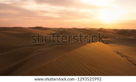 Amazing desert sunset. Beautiful arabian desert with warm colors. Colorful contours of sand dunes at Abu Dhabi.  #1293521992