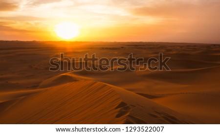 Amazing desert sunset. Beautiful arabian desert with warm colors. Colorful contours of sand dunes at Abu Dhabi.  #1293522007