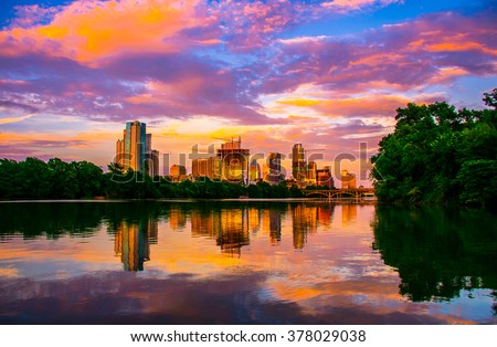 Amazing Dramatic Austin Texas Sunset Mirror Image Town Lake Reflection with an amazing colorful cloud display reflecting on the almost glass like colorado river ATX 2015
