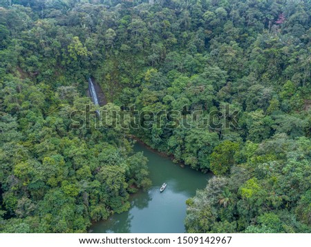 Amazing Drone Photo Of A Waterfall Descending On The Sea. Sierpe Waterfall Located In Bahia Malaga National Natural Park. Zdjęcia stock ©