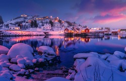Amazing evening on Lofoten. Scenic photo of winter fishing village and colorful sky. stunning natural background. Picturesque Scenery of Reinefjord one most popular place of Lofoten islands. Norway