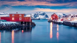 Amazing evening view of Ballstad port. Spectacular winter sunset on Lofoten Islands, Norway, Europe. Splendid sescape of Norwegian sea.  Life over polar circle.