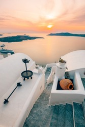 Amazing evening view of Fira, caldera, volcano of Santorini, Greece with cruise ships at sunset. Cloudy dramatic sky landscape, vertical panoramic banner. Beautiful summer sunset vacation scenery