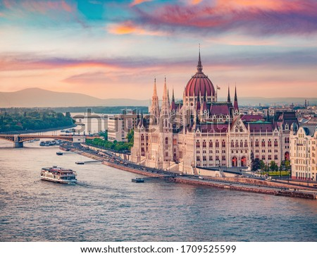 Amazing evening view of Parliament house. Stunning spring cityscape of Budapest. Great sunset in Hungary, Europe. Traveling concept background. Stock fotó ©