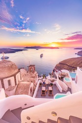 Amazing evening view of Santorini island. Picturesque spring sunset on the famous Greek resort Fira, Greece, Europe. Traveling concept background. Artistic style post processed photo. Summer vacation