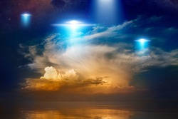 Amazing fantastic background - extraterrestrial aliens spaceship fly above sea, ufo with blue spotlights in red glowing sky. Elements of this image furnished n
