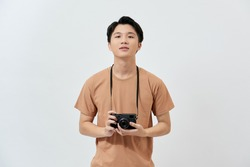 Amazing guy with photo digicam in hands wear casual t-shirt isolated on white background.