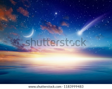 Amazing heavenly background - beautiful glowing sunset with falling comet - mystical sign in sky, rising crescent moon and stars. Elements of this image furnished by NASA #1183999483