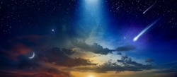 Amazing heavenly image with beautiful glowing sunset, comet and shooting stars, rising crescent moon and bright stars. Elements of this image furnished by NASA