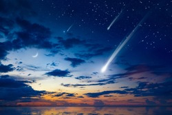 Amazing heavenly image with beautiful glowing sunset, comet and shooting stars, rising crescent moon and bright stars above sea. Elements of this image furnished by NASA