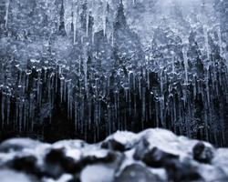 Amazing ice formation in rock cave. Icicles formed by melting ice. Canadian winter scene. Toronto, Ontario, Canada