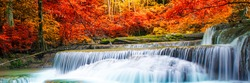 Amazing in nature, beautiful waterfall at colorful autumn forest in fall season, autumn wonderful mood.