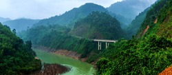 Amazing landscape of mountain jungle. Mountains, jungle forest, river, bridge.