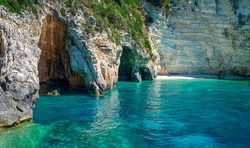 Amazing landscape. The Blue Cave: three exceptional sea caves which are communicating each other. They owe their name to the variety of shades of blue and to the clear waters. Paxos island. Greece.