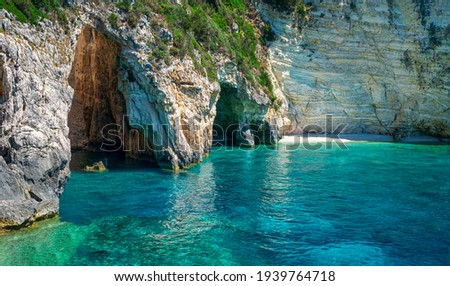 Amazing landscape. The Blue Cave: three exceptional sea caves which are communicating each other. They owe their name to the variety of shades of blue and to the clear waters. Paxos island. Greece. Stockfoto ©