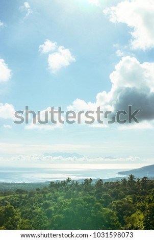 Amazing landscape with ocean, mountains and the island above the clouds in the morning light. #1031598073