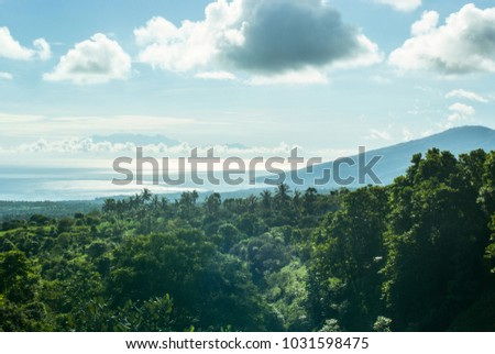 Amazing landscape with ocean, mountains and the island above the clouds in the morning light. #1031598475