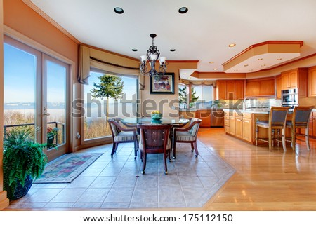 Amazing large luxury kitchen room and dining area with stunning mountain view. Combined hardwood and concrete floor, coffered ceiling