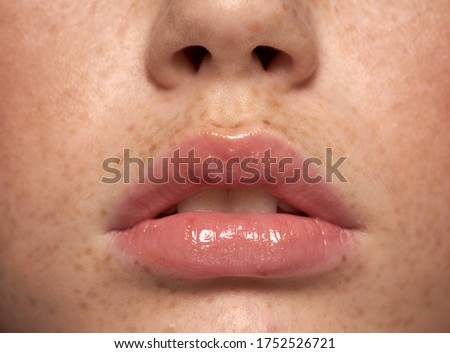 Amazing Lips young woman with Freckles Perfect Skin Closeup perfect natural lip makeup. Beautiful plump full lips on female face. Spa tender lips.