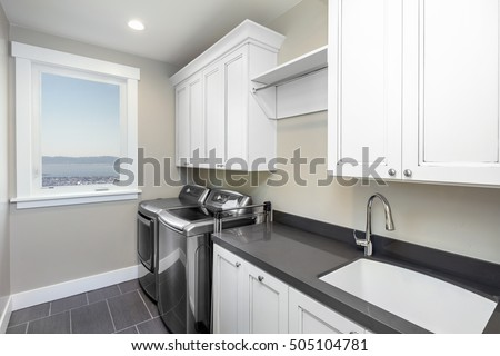 Amazing modern laundry room with modern appliances #505104781