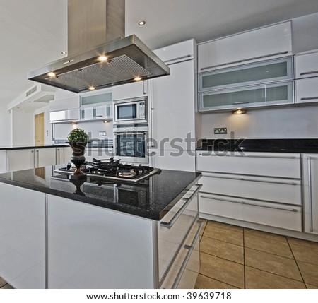 amazing modern penthouse kitchen with breakfast bar