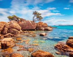 Amazing morning scene of popular touris deastination - Capriccioli beach. Scenic public beach with sand & granite rocks nestled in a cove with Mediterranean greenery, Sardinia, Italy, Europe.