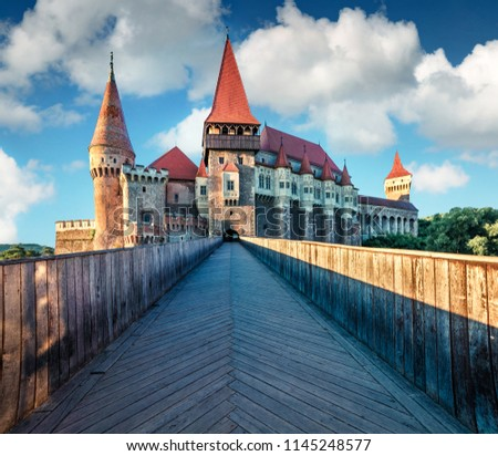Amazing morning view of Hunyad Castle / Corvin's Castle. Great summer cityscape of Hunedoara town, Transylvania, Romania, Europe. Romanian castle landmarks. Traveling concept background.